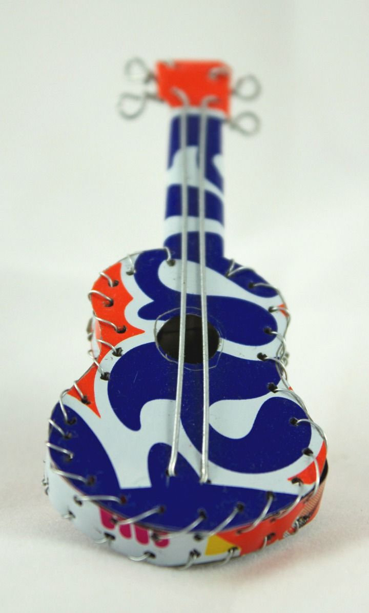 Mini guitar made from re-cycled soda cans and wire. Stribal.com from Africa