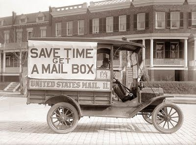 The picture above was taken in 1916, and shows a mail delivery truck. The truck has a sign promoting the idea that people should get a mailbox on the street. This would save the mailman the time of walking to the front door of each home.