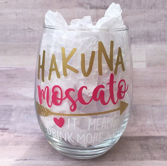 Hakuna Moscato - It Means Drink More Wine Stemless Wineglass Images on these glasses are created using a high quality, waterproof, permanent vinyl.  Color changes are available to this item, please message me to check availability prior to ordering [Colors in photographed image:Gold, Pink & White]   -Hand Wash Only -No Soaking -Not Microwave Save Is recommended for these glasses to allow the beauty of them to continue! ---Because each glass is decorated by hand some may vary slightly from…