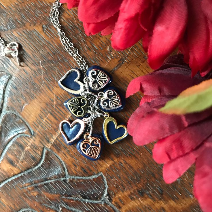 Multiple polymer clay and metallic charm necklace. $20.00 https://www.etsy.com/listing/574779092/boho-necklace-long-boho-necklace-tribal-boho-necklace-pagan-necklace-festival-necklace-amulet-necklace-talisman-necklace-fantasy-necklace