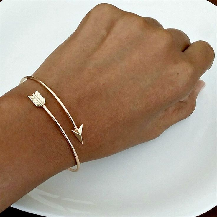 This Dainty Arrow Wrap Bangle Bracelet can be worn alone for a minimal look or purchase more than one and be on trend by stacking and layering each bracelet for a fun and chic arm party. Great for gift giving and Excellent style for everyday wear!Item Details:  Adjustable SizeGold Plated or Silver PlatedHappy Shopping! XO :-)