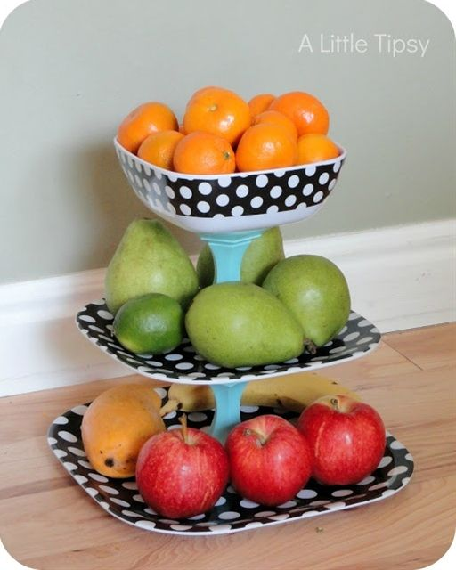 A Little Tipsy: home decor DIY fruit stand. Two plates, different sizes, one bowl, two candle stands