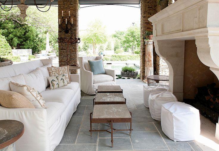 Suzie Aidan Gray Home Pool Cabana With Stone Fireplace Slate Tiles Floor White Slipcover