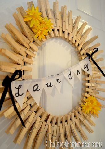 clothespin wreath...I added three ranunculus flowers to mine and didn't add a laundry banner...