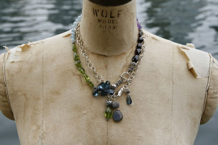 Layer necklaces for more impact. One is a mix of gems including London blue topaz, peridot, garnets, aquamarines, and amethysts. The other is a silver chain with three big, bold pendants - peridot, labradorite, and London blue topaz.