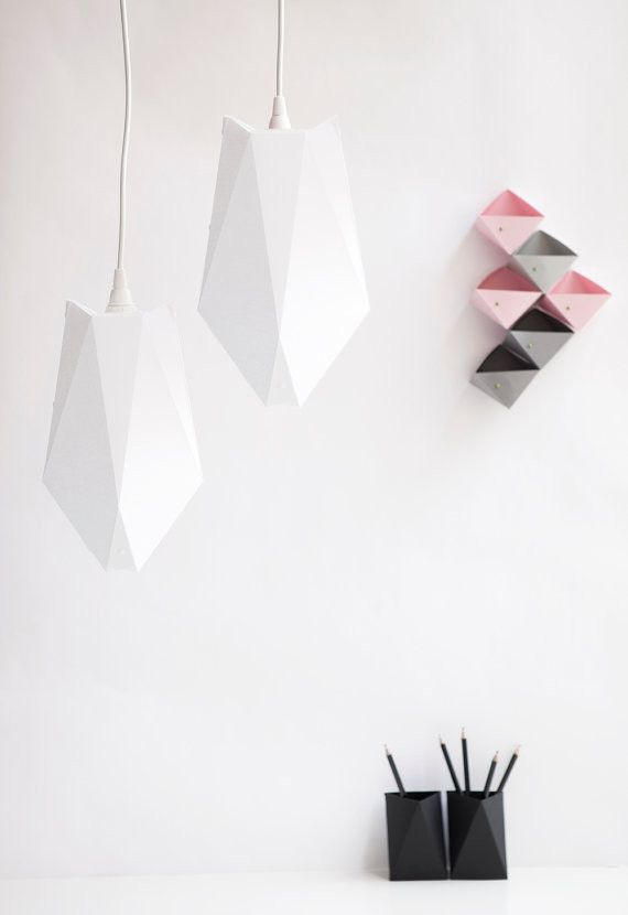 Lamp A4 White is a foldable paper lampshade made with die-cutting technique. This paper light shade is thought as a decorative light that can be hang from the ceiling, bookshelf or simply placed on th