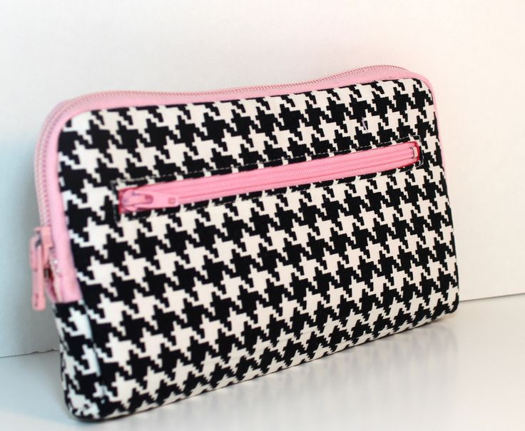 houndstooth black and white with pink zippers and lining.