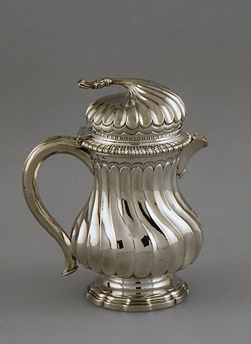 """Hot milk pot, France, ca.1746-1749, Silver. """"The lid's finial, which also serves as a thumbpiece for raising the lid, is in the form of a nightcap tassel, an allusion that would have been appropriate for hot milk, which was served with coffee in the morning."""" Met Museum"""