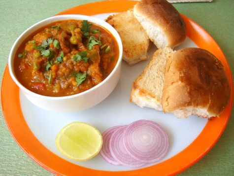 Pav Bhaji.. A Gujarati Dish with toasted Indian bread and a mixture of vegetables together.. Eaten best with lots of butter :P