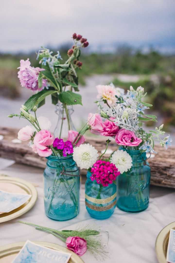 fuchsia, pink and cream florals work beautifully against the turquoise mason jar vases. rich pops of colour that are simple but dramatic.   www.trixandtrumpet.com
