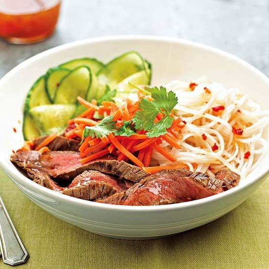 To make this simple supper, toss flank steak, rice noodles, julienned carrots, and diced cucumber with a light and sweet Asian chili sauce. Yum!