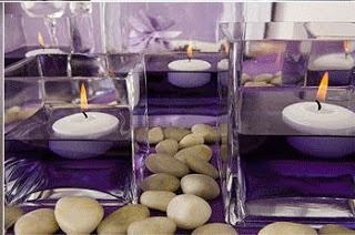 Purple centerpieces - colored water with floating candles