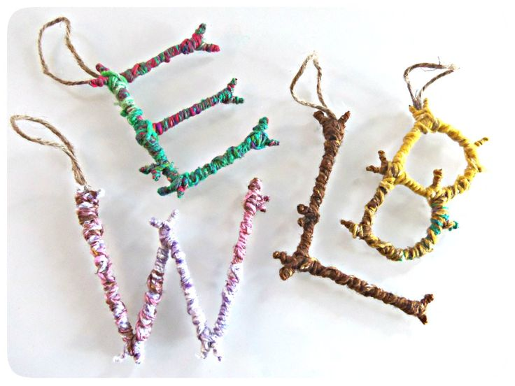 Stick Ornaments DIY. This would be a fun little craft to do with the kids. Also to teach letter recognition.