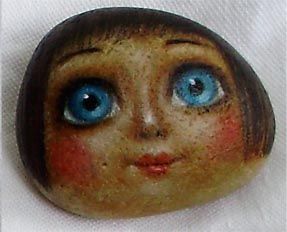 Doll face on a stone - painted rock - a doll face with big blue eyes - beautiful