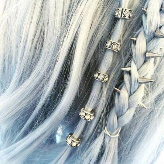 Metal hair accessories. Love love love the spikey braid.