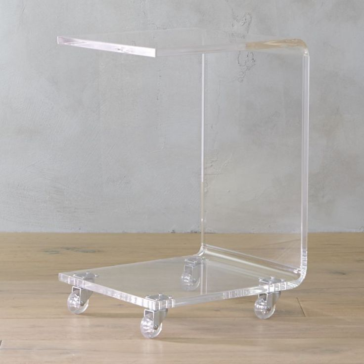 "Shop peekaboo acrylic c table.   This transparent ""C"" rolls in on four clear acrylic casters.  Thick molded acrylic adds clean mod edge in one seamless turn."