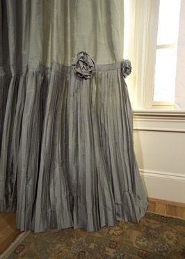 """Romantic Rosettes - your eye is drawn [or line of vision] to the bottom of the side panel, using a crinkle pleated fabric as a contrast skirt.  A couple of fabric rosettes add that extra designer touch."""""""