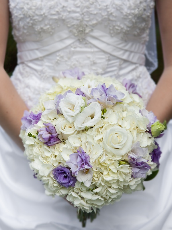 Bridal bouquet of hydrangea, roses, freesia and lisianthus
