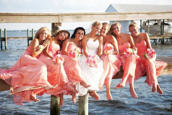 Forget formal photos — this shot of these carefree barefoot beauties proves that natural photos take the cake. If you have a waterfront wedding, find the dock nearest you