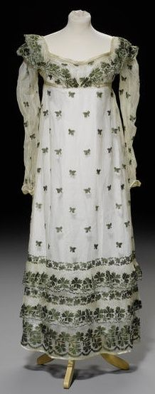 A day dress of ivory silk gauze, circa 1810, with an all over leaf design in green silk thread.
