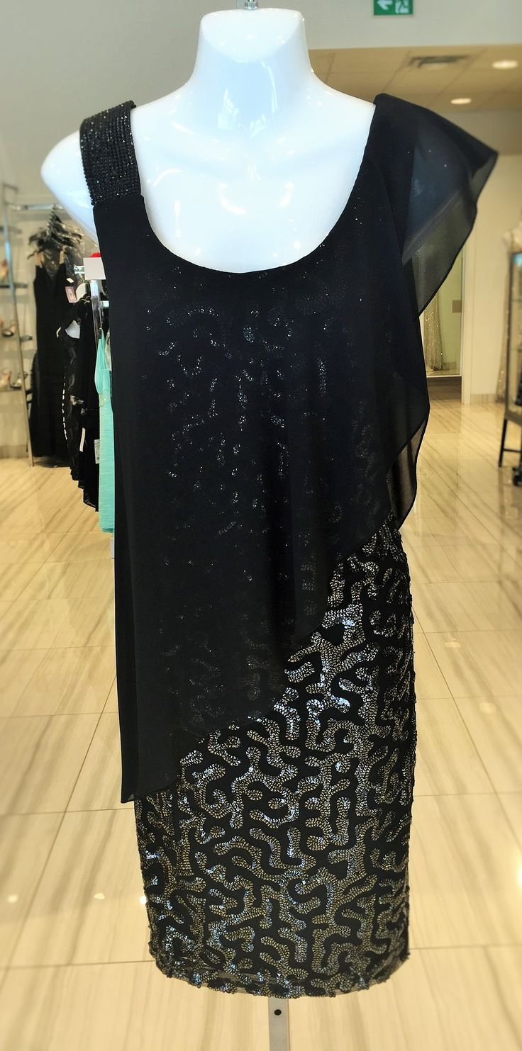 Elegant knee length dress with beading on the shoulder and throughout the body of the dress with a soft chiffon draped across the front for a very flattering fit.