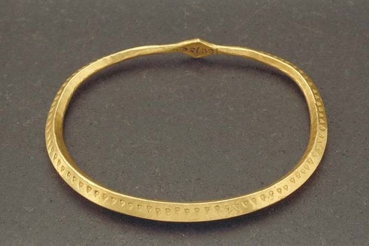 Viking gold arm ring. Found at Hässleberga, Sweden. The Swedish History Museum