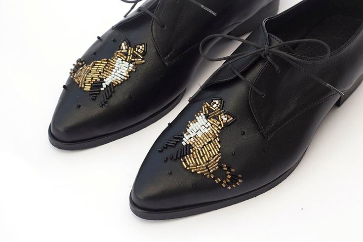 """Name: Women's Lace-Ups —Gold Bead Embroidery of a Fox • Designer: Hadas Katz • Description: """"Materials: black leather, beads, special strong sewing thread and not glue."""" — """"Free Shipping! Flat Leather Shoes, Black Leather Shoes, Oxford Shoes, Women's Lace-Ups —Gold Bead Embroidery of a Fox"""" by Katz and Birds, Etsy (Retrieved: 18 February, 2015)"""