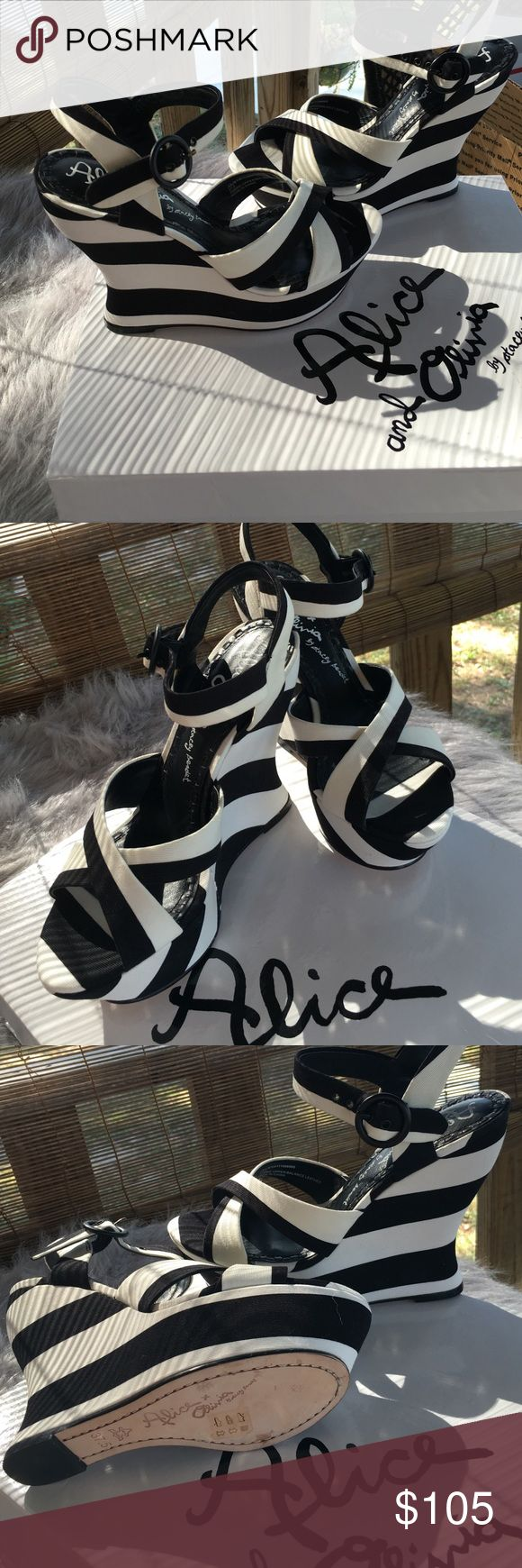 Alice & Olivia wedges Absolutely gorgeous Alice & Olivia black and white stripe wedges . Pictures do no justice to these wedges , these are awesome . I purchased these brand new online and they sent me the wrong size :( they are brand new in original box . A must have :) Alice + Olivia Shoes Wedges