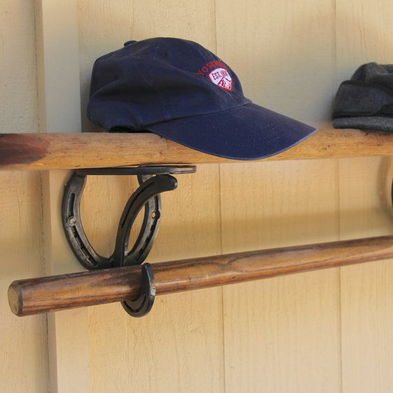 Storage solution, 2 Horseshoe Shelf Brackets. Add a board and you have a great shelf with hooks to hang your coats and hats. By BlacksmithCreations, $89.00