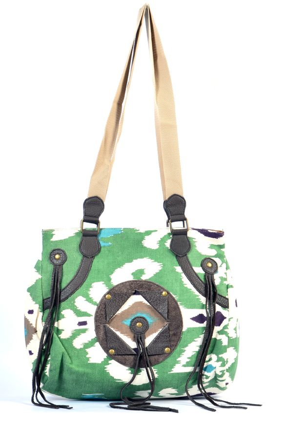 #styleincraft #Antiquecollection #Handmadebags #Handmadeitems  An elegant military colored canvas work bag with genuine leather handle. All the elements which go into making a quality product is monitored right from the first stage of leather selection to finishing of the product at their manufacturing facility. An aesthetic print, invaluable artistic skill, an
