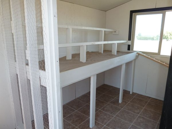 "Great Idea! - Roosting rails and poop deck.  We put ""stall dry"" (a sandy-like material that is used for livestock stalls and is not harmful to animals) down.  I use a kitty litter scoop to clean it about every other day."