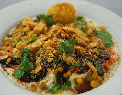 13 best shravan special images on pinterest sanjeev kapoor dilli aloo tikki chaat a complete meal in itself alootikki served topped with yogurt green and sweet chutneys sev and othe chaat ingredients forumfinder Choice Image