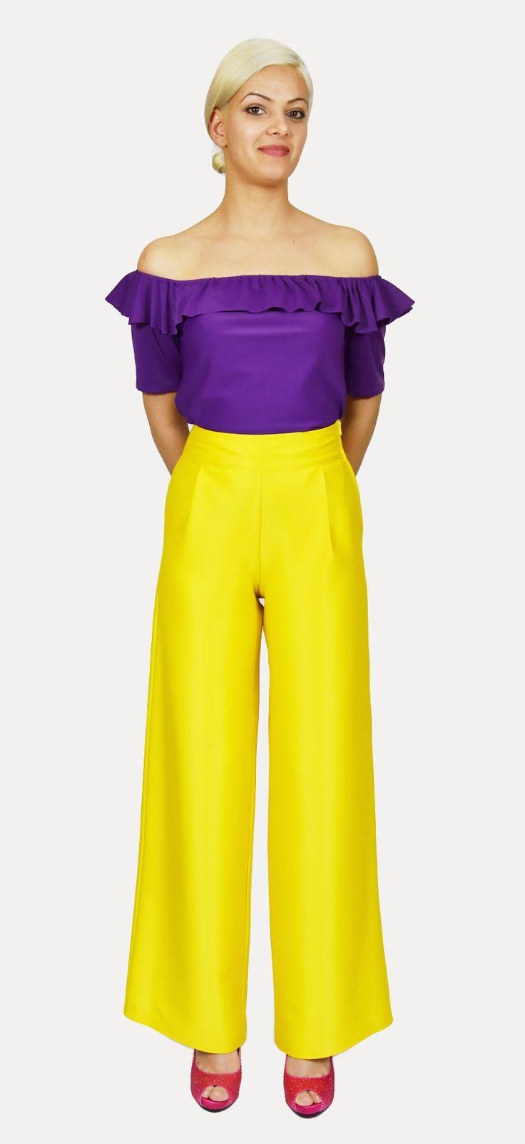 Pantalón Amarillo en tejido Fama, cinturilla alta y cremallera en el lateral,lleva pinzas. Ancho de pierna, muy comodo y elegante.