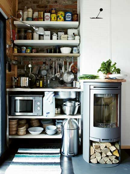 Tiny kitchen in a Finnish cabin--everything you could need: little sink, single-burner cooktop, wood oven, toaster oven, filtered water on tap, dishes & utensils.  Efficient and back-to-basics style!
