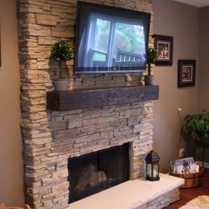 stack stone fireplaces with plasma TV mounted