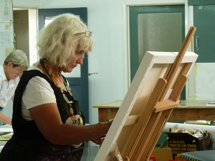 Trish busy at work on her canvas