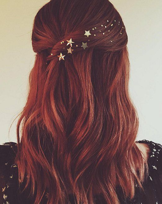 Amazing red hair with pretty golden stars. #PANDORAloves this hairdo.