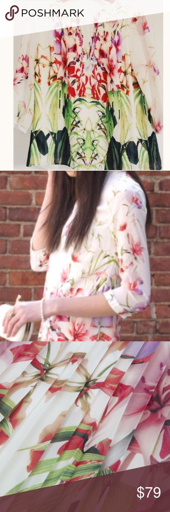 Ted Baker Zumbel Mirrored Tropics Pleated Blouse AUTHENTIC Ted Baker Zumbel Mirrored Tropics Pleated Blouse  Cut to a flattering fit and pleated finish, this top with a rounded neckline, three-quarter length sleeves and a vibrant mirrored tropics print is sure to get you noticed. Team yours with skinny-fit jeans and flats for contemporary weekend wear that has plenty of statement appeal.  Condition: New, unworn, without tags. This was purchased with a mark through the label only to prevent…
