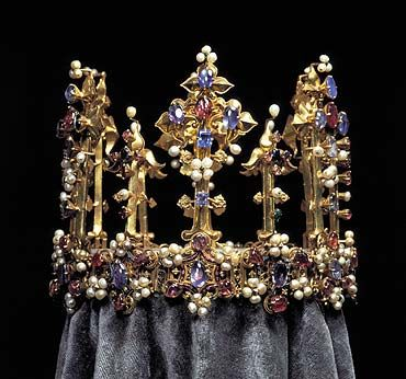 Made for Richard II and worn by his wife and then given as part of the dowery along with an English Princess a few years later when she married into a german royal house. This is the only reason it survived the brutal melting down of the crown jewels by Oliver Cromwell and so it is the last English Medieval crown still in existence. As well as the large rubies and sapphires, there are small emeralds and diamonds and some enamel work too. and the obvious pearls.