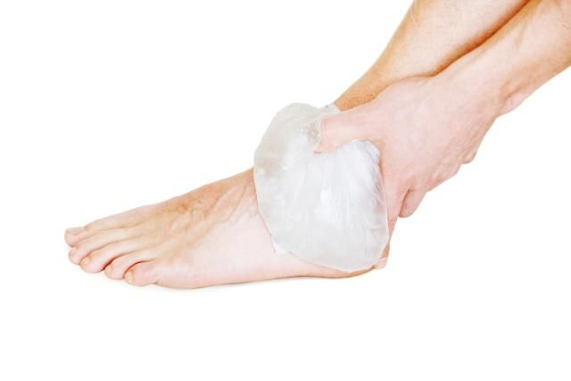 Your 6-Step Guide to Treating a Sprained Ankle: Ice application is helpful to reduce pain and swelling after an ankle sprain.