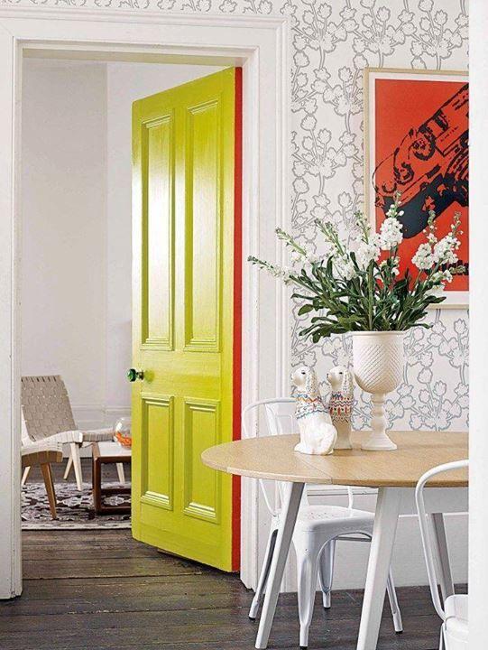 Bright doors, fun wallpaper. via SA Sacor The red one the door