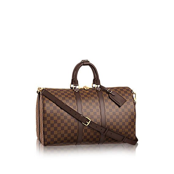 Discover Louis Vuitton Keepall 45 with Shoulder Strap  Travel light, but always in style. Since 1930, Vuitton's Keepall duffle has journeyed alongside generations of elegant globetrotters. This version, the smallest of the line, holds all the essentials for an overnight jaunt. In Damier Ebene canvas with comfortable-to-hold leather handles, a strap for casual cross-body wear and a gleaming brass padlock.