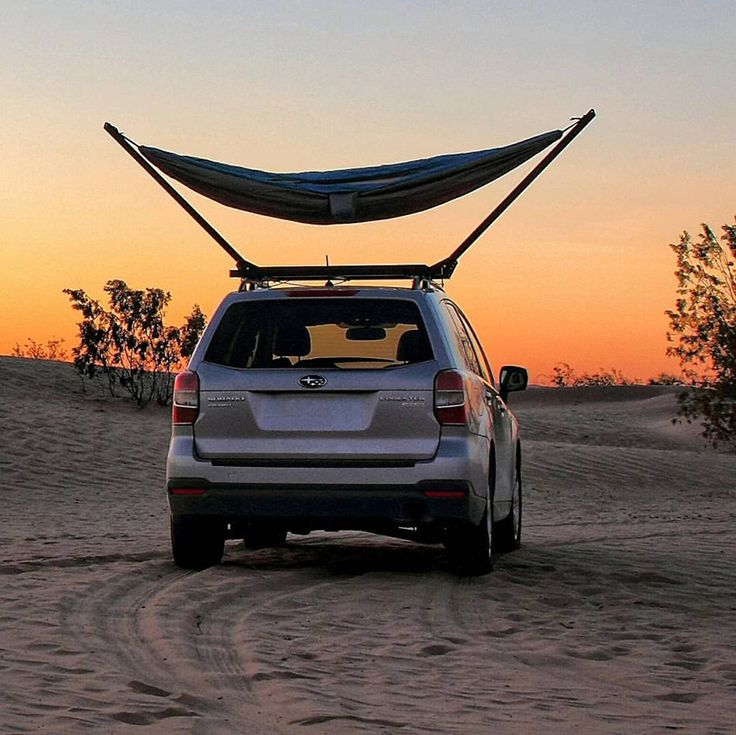 the trailnest hammock stand clamps securly to the existing roof bars of your car letting you experience vehicular camping from an entirely new perspective.