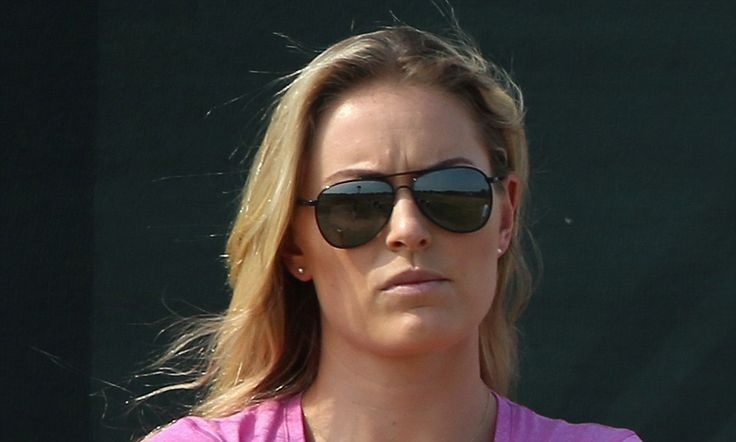 Lindsey Vonn looks glum watching Tiger Woods struggle in British Open