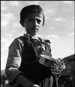 GREECE. Ioannine. 1948. A young Greek boy, in a camp for refugees from the war areas, plays with a homemade wagon constructed from a leaky tin food container and other pieces of tin he has found. He draws this wagon along with a string.  David Seymour