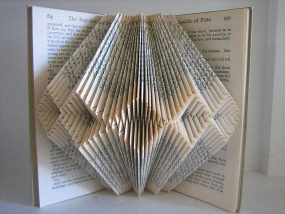 26 best folded book art images on pinterest folded book for Paper folding art projects