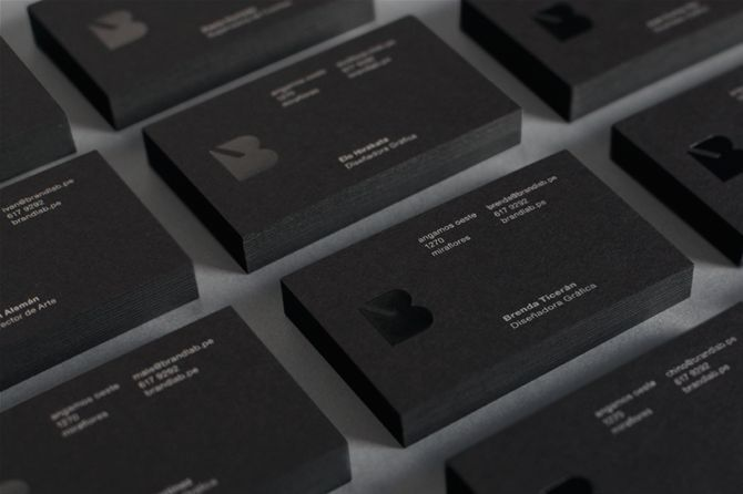 Brandlab business cards with black block foil detail.