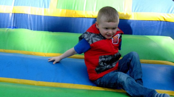 Max not sure if he actually wants to bounce in the bouncy house.
