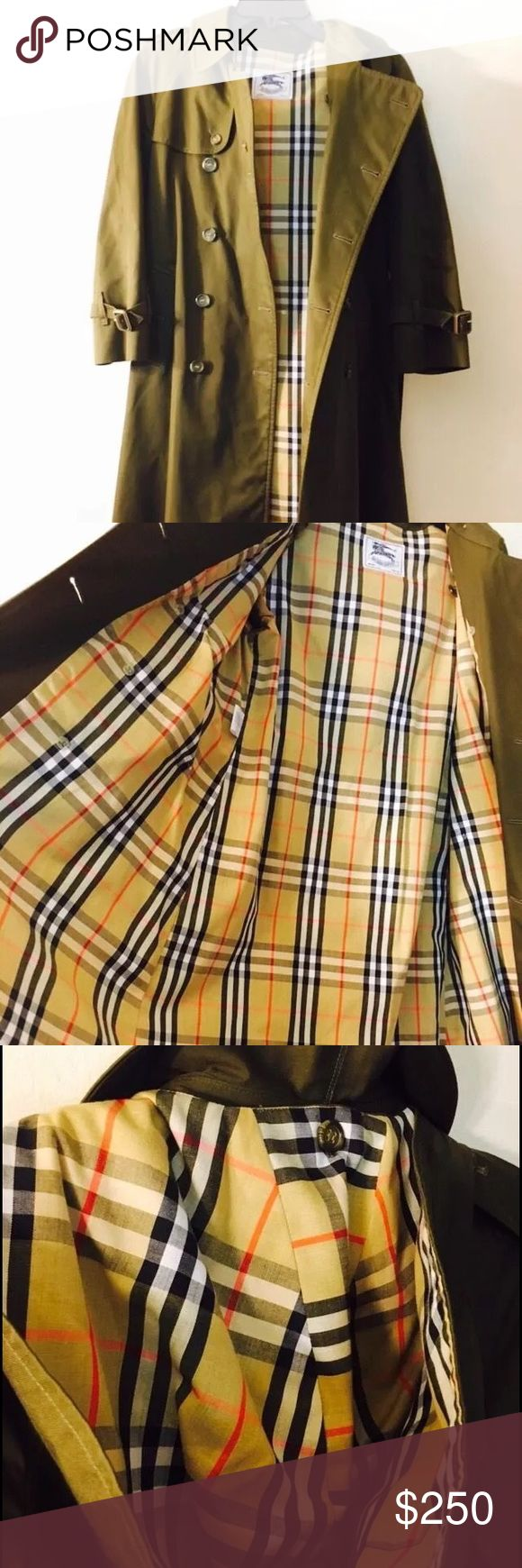 """NWOT BURBERRY GIRLS TRENCH COAT AGES 11/12 Fits Women's Petite.                                     16 inches across for the Chest measurement with the buttons closed.  100% AUTHENTIC BURBERRY CLASSIC COAT!! APPROXIMATE MEASUREMENT SHOULDER TO SHOULDER 19"""". This coat is used but still in mint condition. The hood is removeable, and the belt is still here, in mint condition (see photos) The coat measures 38in long. The sleeve, measuring from the bottom of the arm pit is 13 inches. It is a dark…"""