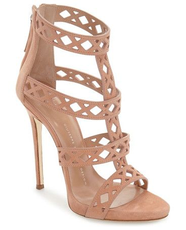 geometric cage sandal by Giuseppe Zanotti. A laser-cut cage sandal crafted in Italy from lush suede features a sky-high heel that furthers the sensual appeal.